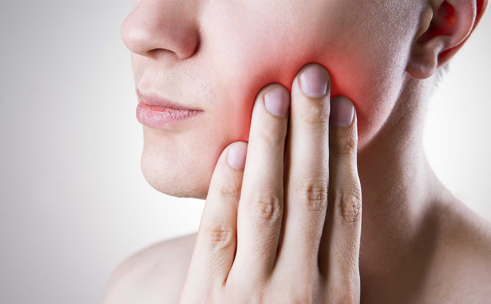 man feeling pain in mouth | The Top 5 Dental Emergencies and What to Do